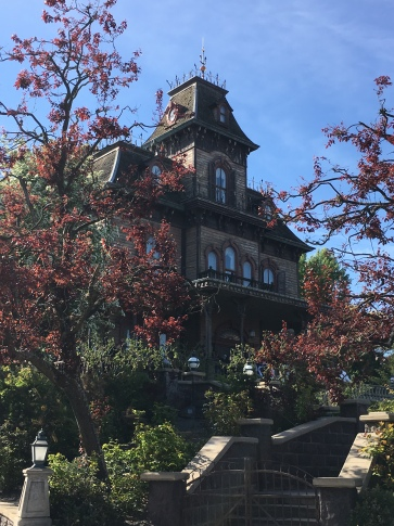 At Disneyland Paris, the Haunted Mansion sits on a hill full of trees. It's isolated in a way that it can't be in Anaheim and Orlando.