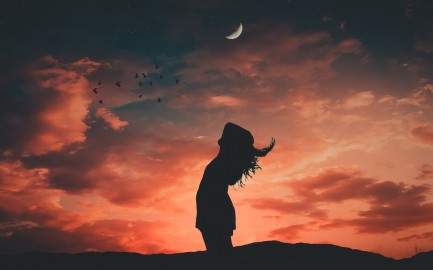 sunset-woman-silhouette-crescent-clouds
